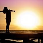 successful woman sunset